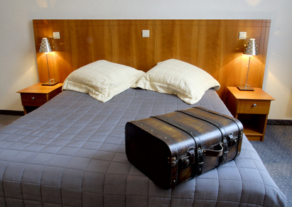 hotel room with suitcase